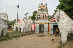 Village hindu temple in India with clay horses Stock Photo
