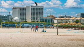 Kids playing beach football near the town`s major hotels including, Crowne Plaza. VilaMoura, Algarve, Portugal - June 2nd, 2018: Kids playing beach football near Stock Photography