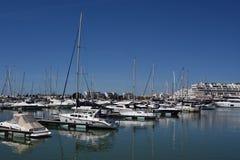 Marina Vilamoura , Algarve, Portugal, Europe. Vilamoura, Portugal - March 26, 2018: Luxury Yachts and motor boats moored at the marina of Vilamoura with stock image