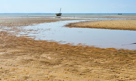 Vilanculos Beach, Mozambique. Panoramic View of Vilanculos Beach in Mozambique during low tide. One can see the various dhows resting in the sand Royalty Free Stock Photography