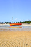 Vilanculos Beach, Mozambique. Panoramic View of Vilanculos Beach in Mozambique during low tide. One can see the various dhows resting in the sand Stock Photography