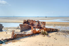 Vilanculos Beach, Mozambique. Panoramic View of Vilanculos Beach in Mozambique during low tide. One can see the various dhows resting in the sand Stock Images