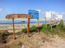 Vilanculos Beach, Mozambique. Vilankulo, Mozambique - July 7, 2012: Signs along Vilanculos Beach in Mozambique Stock Images