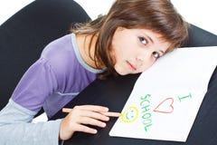 vilande schoolgirl för gulligt skrivbord Arkivfoto