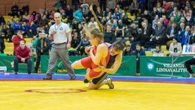 Viljandi, ESTONIA - FEBRUARY 20, 2016: Unidentified wrestlers during Estonian freestyle wrestling tournament. Freestyle wrestling tournament. Wrestlers on mat Royalty Free Stock Images