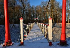 Viljandi suspension bridge shooted in sunny winter day. Some snow on the bridge and footmarks. Viljandi suspension bridge shooted in sunny winter day with wide Stock Photos