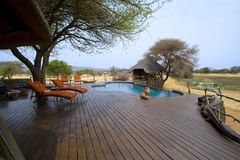 The Villa. The 5 star villa at Okonjima with infinity swimming pool overlooking the water hole Stock Photo