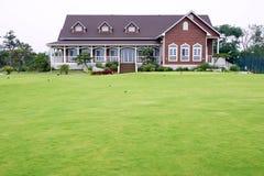 Villa. The beautiful villa with grassplot Royalty Free Stock Photos