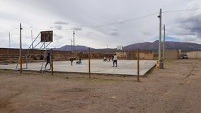 People playing in a basketball court in the village of Villa Alota, Bolivia stock photo