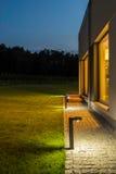 Villa backyard illuminated at night Royalty Free Stock Photos