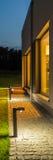 Villa backyard illuminated at night Royalty Free Stock Images