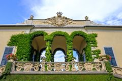 Villa Balbianello building balcony. Villa Balbianello building with green ornaments on balcony. Sunny day. Lake Como, Italy stock images