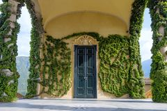 Villa Balbianello building with green ornaments. Sunny day. Lake Como, Italy royalty free stock images