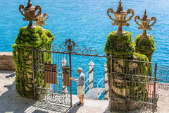 Villa Balbianello, Como lake, Italy. VILLA BALBIANELLO, ITALY - AUGUST 02, 2015: View of classic metal gates and pier at villa Balbianello, Como lake, Italy stock photo