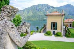 Villa Balbianello with statue in the garden. Mountains on background. Lake Como, Italy royalty free stock photos