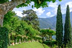 Villa Balbianello yard with green trees. And ornaments. Sunny day. Lake Como, Italy royalty free stock photo