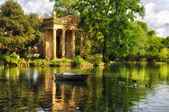 Villa Borghese, Rome, Italy. The Temple of Esculapio in the park Villa Borghese with boat and ducks royalty free stock photo