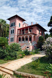 Villa Carolina in Cikat in Mali Losinj,Croatia. Pink villa Carolina in Mali Losinj with the green garden and palm trees Stock Photography
