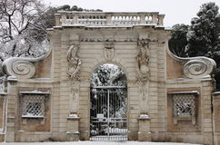 Villa Celimontana portal under snow. ROME - FEBRUARY 4: Villa Celimontana portal after the heavy snowfall on February 4, 2012 in Rome. The last snowfall in Rome Royalty Free Stock Image