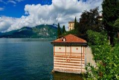 Villa Cipressi from lake como. View along the lake to villa cipressi royalty free stock image