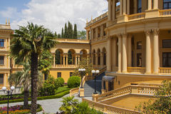 Villa colonade. Beautiful villa in ancient greek classic style with landscaped green territory; outdoor panorama with copy space Stock Photos