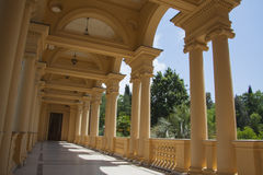 Villa colonade. Beautiful villa in ancient greek classic style with landscaped green territory; outdoor panorama with copy space royalty free stock photos