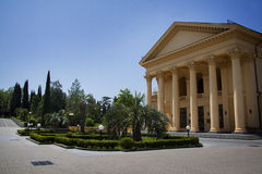 Villa colonnade. Beautiful villa in ancient greek classic style with landscaped green territory; outdoor panorama with copy space royalty free stock photography