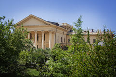 Villa colonnade. Beautiful villa in ancient greek classic style with landscaped green territory; outdoor panorama with copy space royalty free stock photos
