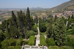 Villa d`Este, tree, landmark, sky, city. Villa d'Este is tree, city and historic site. That marvel has landmark, plant and mountain and that beauty contains sky royalty free stock photo
