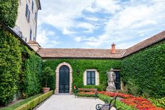 Villa del Balbianello green garden. With chapel. Clouds on background. Lenno, Italy stock photo