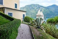 Villa del Balbianello green garden. Lake Como on background. Lenno, Italy royalty free stock photography