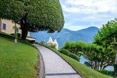Villa del Balbianello green garden. Mountains and Lake Como on backround. Lenno, Italy stock photography