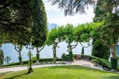 Villa del Balbianello green garden. Sunlight reflecting on grass. Lake Como on background. Lenno, Italy stock photos