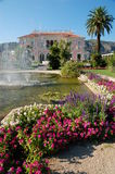 Villa Ephrussi de Rotschild garden. Villa Ephrussi de Rotschild on Saint-Jean-Cap-Ferrat near Nice in France, garden with fountain Royalty Free Stock Photography
