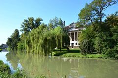 Villa Foscari, named La Malcontenta, designed by Andrea Palladio architect. Year 1565, on Brenta river near Venice in Italy - aug 06 2014 Stock Image