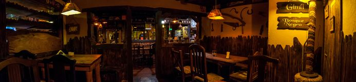 VILLA GESELL,ARGENTINA-MARCH 21,2018:Panoramic of interior of an irish pub. Translation of dark forest in spanish stock photography