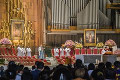 Mass inside the New Basilica of Guadalupe. VILLA OF GUADALUPE, MEXICO CITY, AUGUST 08, 2008 - Mass officiated inside the New Basilica of Guadalupe with the royalty free stock image
