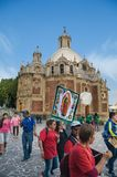 Pilgrimage to the Basilica of Guadalupe. VILLA OF GUADALUPE, MEXICO CITY, DECEMBER 02, 2017 - Pilgrims from the Teofani region in Hidalgo, Mexico, carry a royalty free stock photos