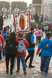 Pilgrimage to the Basilica of Guadalupe. VILLA OF GUADALUPE, MEXICO CITY, DECEMBER 02, 2017 - Pilgrims from the Teofani region in Hidalgo, Mexico, carry a royalty free stock images