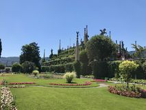 Villa Isola Bella Gardens with Trees and Flowers. Beautiful park on the island of Isola Bella in Lago Maggiore, Italy,Lombardy ,Northern Italy stock photography