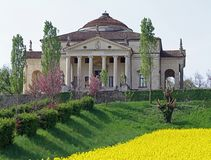Villa La Rotonda with yellow flower field o f rapeseed in Vicenz Stock Images