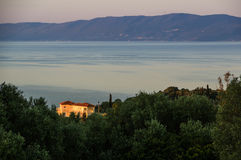 Villa lit by the Greek sunrise Stock Photo