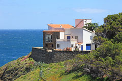Villa at mediterranean seashore. Stock Photo