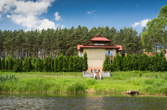 Villa near the forest and river Royalty Free Stock Images