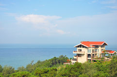 Villa near the ocean. Around by the green trees Royalty Free Stock Images