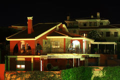 Villa with night colors. Illumination royalty free stock image