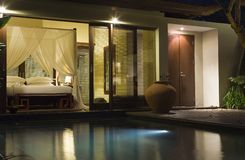 Villa in night illumination. And pool before her royalty free stock images