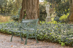 Villa Ocampo Garden in San Isidro Buenos Aires. Iron chair in the garden of Villa Ocampo, and old style classic building of San Isidro which was the historic stock images