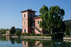 Villa at orbetello lagoon stock photography