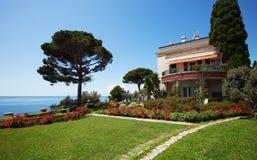 Villa park overlooking sea, summer day royalty free stock photography